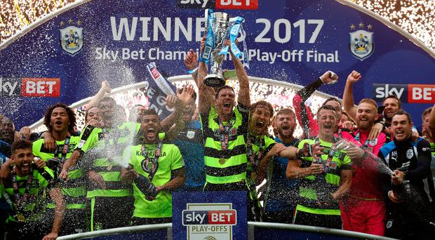 Going up: Huddersfield celebrate their playoff win and promotion to the Premier League