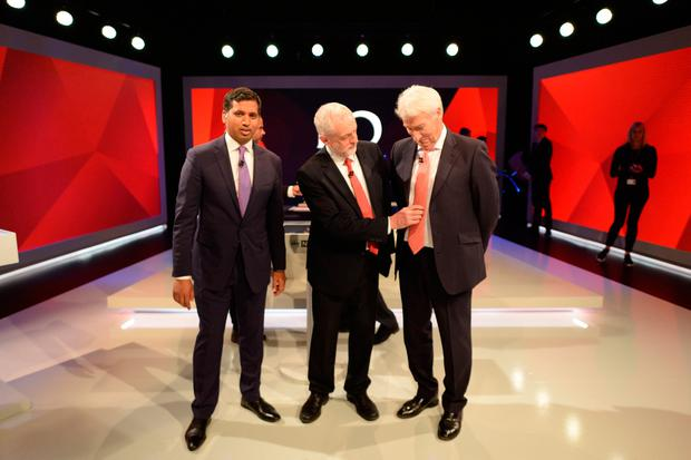 Labour leader Jeremy Corbyn (centre) adjusts the tie of Jeremy Paxman (right) next to Sky News political editor Faisal Islam during a joint Channel 4 and Sky News general election programme 'May v Corbyn Live: The Battle for Number 10' at Sky studios on May 29, 2017 in London, England. (Photo by Stefan Rousseau - WPA Pool/Getty Images)