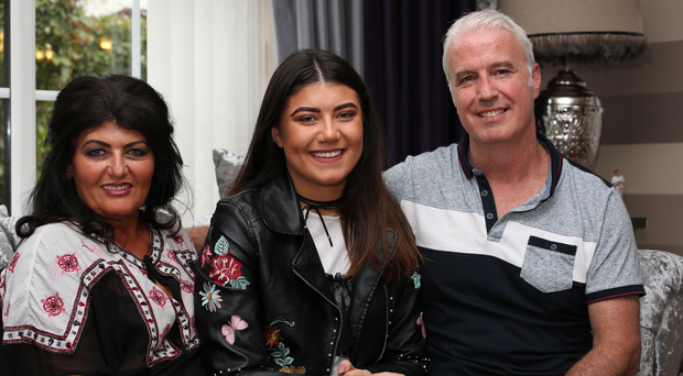Niamh Woods at home in Derry with her dad Sean and mum Bernie