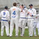 Joy and pain: North West Warriors players celebrate after Shane Getkate's dismissal