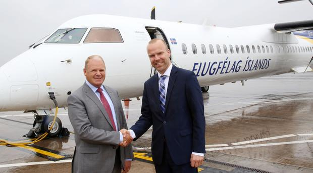 Brian Ambrose, chief executive of Belfast City Airport, welcomes Arni Gunnarsson, chief of Air Iceland Connect, to Belfast as the first flight on the new Icelandair route from Belfast City Airport to Reykjavik arrived today. Pic Darren Kidd/Presseye