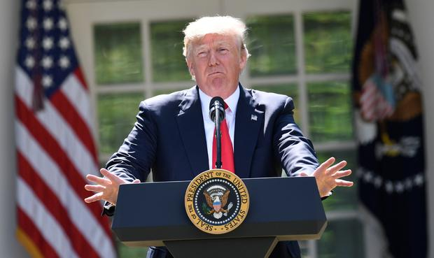 US President Donald Trump announces his decision on the Paris Climate Accords in the Rose Garden of the White House in Washington, DC, on June 1, 2017. AFP/Getty Images