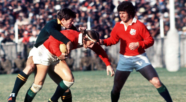 Flashback: JPR Williams tackled by Jan Ellis with Dick Milliken looking on as South Africa and the Lions clashed in 1974
