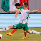 Mexico's Oribe Peralta (19) drives the ball past Ireland's Shane Duffy (4) during the friendly match between Mexico and the Republic of Ireland on June 1, 2017 at MetLife Stadium in East Rutherford, New Jersey. / AFP PHOTO / Kena BetancurKENA BETANCUR/AFP/Getty Images