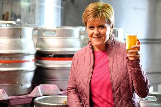 SNP leader Nicola Sturgeon has a ping of beer as she takes a tour of Kelburn Brewery while campaigning for the General Election on June 2, 2017 in Barrhead, East Renfrewshire, Scotland. (Photo by Jeff J Mitchell/Getty Images)