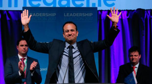 Leo Varadkar celebrates as he is named as Ireland's next prime minister after the votes for the leadership of the Fine Gael party were counted in the Mansion House in Dublin. PA