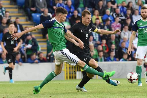 Press Eye - Belfast - Northern Ireland 2nd June 2017 - Picture by Stephen Hamilton / Press Eye. Friendly International match between Northern Ireland and New Zealand at the National Stadium in Belfast. Northern Irelands Tom Flanagan in action with New Zealands Chris Wood