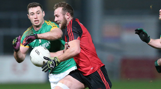 Down to the wire: Darren O'Hagan (in action against Meath) could be pivotal for the Mournemen in what may prove to be a tight contest against fierce rivals Armagh at Park Esler on Sunday