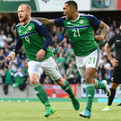 Get in: Josh Magennis is quick to congratulate Liam Boyce after the striker scored his first international goal