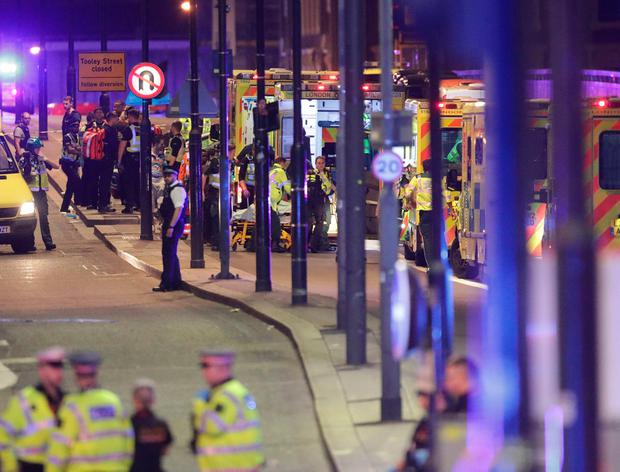 Emergency personnel tend to the wounded on London Bridge. Photo: Yui Mok/PA Wire