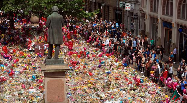 A view of the flowers and tributes left in St Ann's Square following the Manchester Arena terror attack