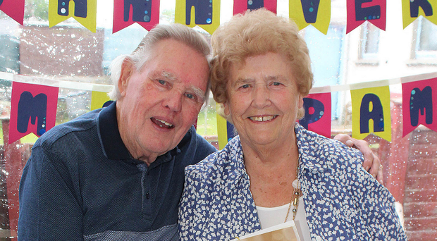 Tom and Pam Darcy from Portrush cut a cake to mark 65 years of marriage