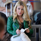 Author Emma Heatherington making notes in a train station
