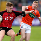 Close attention: Down's Liam Kerr attempts to fend off Armagh's Jack Haddock on Sunday