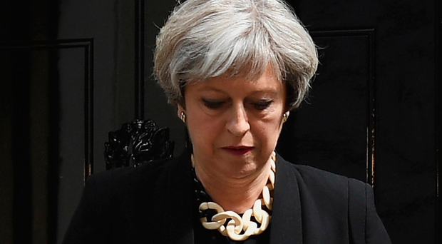 Prime Minister Theresa May arrives to address the media as she makes a statement, following a COBRA meeting in response to Saturday night's terror attack