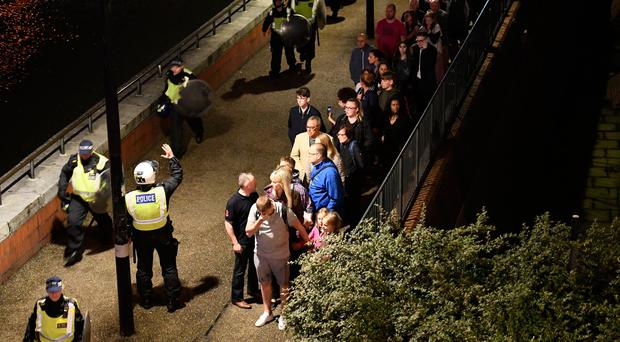 People are lead to safety away from London Bridge