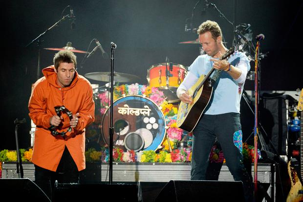Liam Gallagher (left) and Chris Martin (right) performing during the One Love Manchester benefit concert for the victims of the Manchester Arena terror attack at Emirates Old Trafford, Greater Manchester.