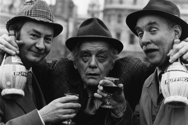 British actors Peter Sallis, Bill Owen (1914 - 1999) and Michael Bates, from left to right, share a drink while in costume as their characters in the long-running BBC comedy series 'Last Of The Summer Wine'. (Photo by Evening Standard/Getty Images)