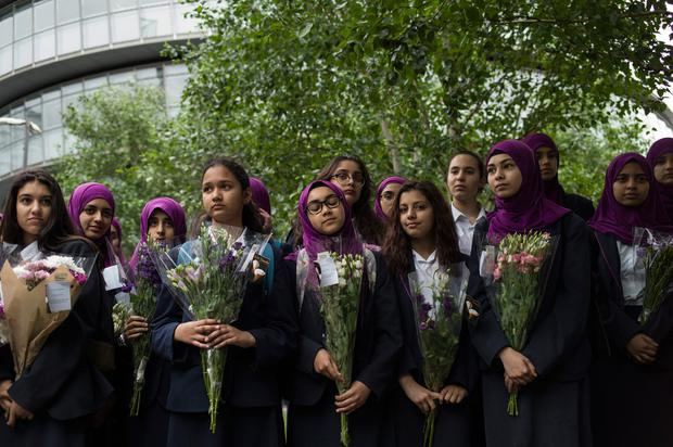 Pupils from Eden Girls' School in Waltham Forest take part in a vigil for the victims of the London Bridge terror attacks, in Potters Fields Park on June 5, 2017 in London, England. (Photo by Dan Kitwood/Getty Images)