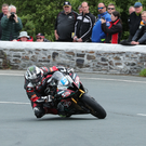 Turning the corner: Michael Dunlop en route to his first TT victory of the week