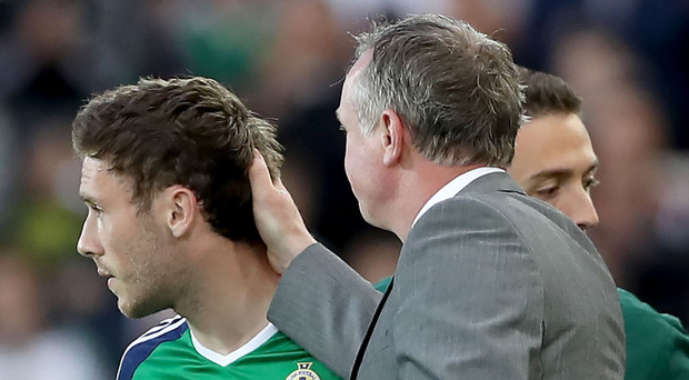 Proud moment: Shay McCartan is given a pat on the head by boss Michael O'Neill as he makes his Northern Ireland debut