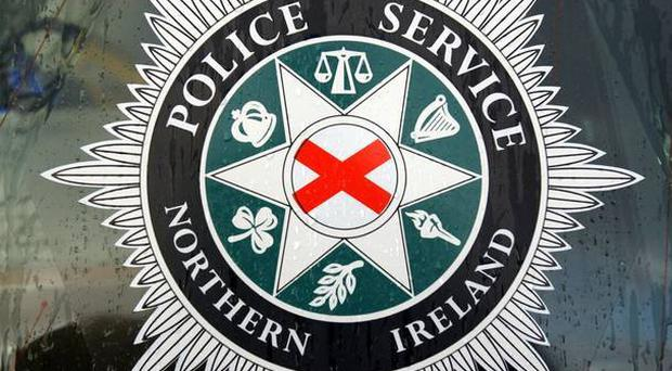 Police in west Belfast are questioning four men after a man and a woman were struck by a BMW which failed to stop.