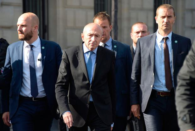 French Minister of the Interior Gerard Collomb (C) walks with officials as he arrives to addresses media representatives near the site of an attack at the entrance of Notre-Dame cathedral in Paris on June 6, 2017. AFP/Getty Images