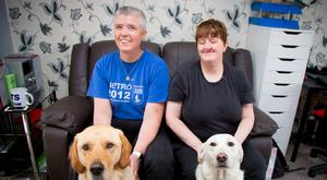 Puppy love: Andrea Hope (right) and her partner Diane Marks with their guide dogs, Morris and Debbie