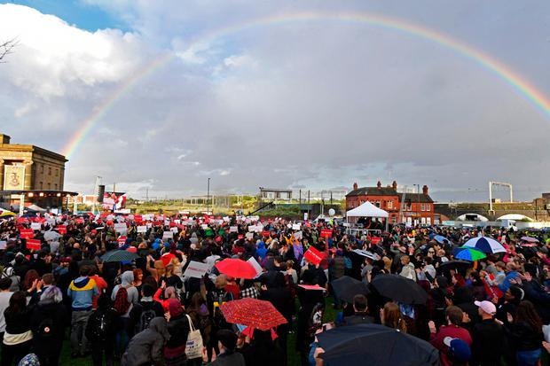A rainbow cuts across the sky as supporters turn up to watch Britain's main opposition Labour Party leader Jeremy Corbyn (C) speak at a general election campaign event in Birmingham, central England, on June 6, 2017. AFP/Getty Images