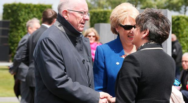 DUP leader Arlene Foster (right) greets Irish Minister for Foreign Affairs Charles Flanagan and Minister for Arts, Heritage and the Gaeltacht Heather Humphreys as they arrive for a ceremony at the Island of Ireland Peace Park in Messines, Belgium to commemorate Battle of Messines Ridge. PA
