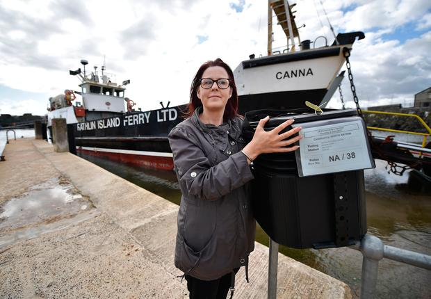 Mandy Hassan, assistant area electoral officer for Antrim and mid Ulster stands with her ballot box waiting on the ferry destined for Rathlin Island on June 7, 2017 in Rathlin Island, Northern Ireland. Rathlin islanders receive the ballot box a day earlier than the mainland due to weather concerns. The island has an eligible 99 voters with an on average turnout of eighty per cent. (Photo by Charles McQuillan/Getty Images)