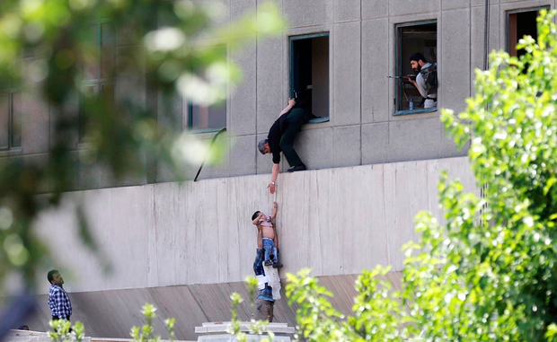 A child is lowered from a window in the Iranian parliament building following an attack on June 7, 2017 in Tehran, Iran. (Photo by Omid Vahabzadeh/Getty Images)