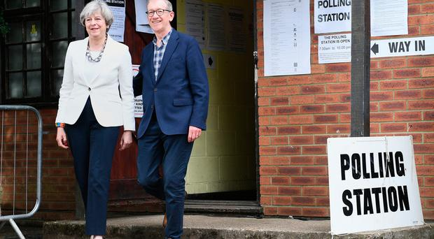 Britain's May reaches 'outline' power deal after election