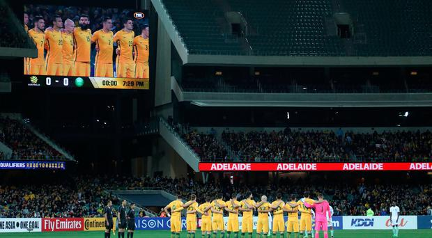 Australia observes a minute's silence, to honour those lost in the recent terrorist attacks, during the 2018 FIFA World Cup Qualifier match between the Socceroos and Saudi Arabia at the Adelaide Oval on June 8, 2017 in Adelaide, Australia. (Photo by James Elsby/Getty Images)