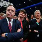 DUP leader Arlene Foster (2nd L), DUP deputy leader and north Belfast candidate Nigel Dodds (L), former DUP leader and Northern Ireland First Minister Peter Robinson (R) watch on during the Belfast count centre (Photo by Charles McQuillan/Getty Images)