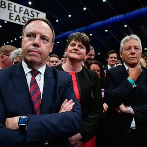 DUP leader Arlene Foster (2nd L), DUP deputy leader and north Belfast candidate Nigel Dodds (L), former DUP leader and Northern Ireland First Minister Peter Robinson (R) watch on during the Belfast count centre on June 9, 2017 in Belfast, Northern Ireland.