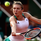 Fighting on: Simona Halep is battling an ankle injury