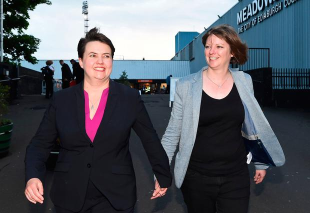 Scottish Conservative leader, Ruth Davidson leaves with her partner Jen Wilson after visiting the Meadowbank Sports Centre counting centre in Edinburgh, Scotland, on June 9, 2017, hours after the polls closed in the British general election. AFP/Getty Images