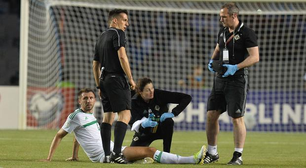 Northern Ireland's Gareth McAuley gets injured during the game at Tofiq Bahramov Stadium, Baku. Photo Colm Lenaghan/Pacemaker Press
