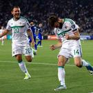 Northern Ireland's Stuart Dallas (right) celebrates scoring in Azerbaijan.