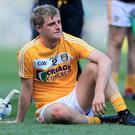 Beaten: Antrim's Eoghan Campbell looks dejected at the final whistle. Photo: Donall Farmer/INPHO