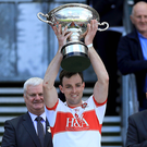 Champions: Oisin McCloskey lifts the Nicky Rackard Cup. Photo: Donall Farmer/INPHI