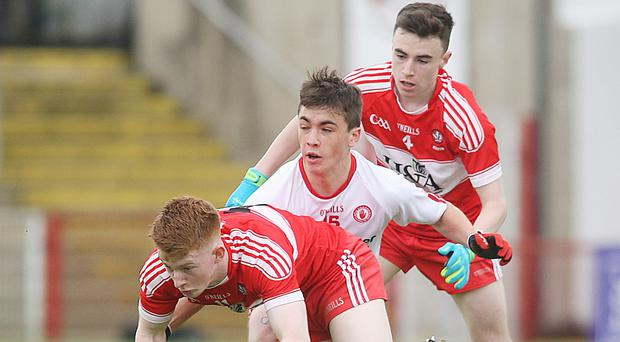 Derry's Declan Cassidy and Sean McKeever with Tyrone's Darragh Canavan. Photo: Lorcan Doherty/Presseye