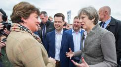 Arlene Foster with Theresa May and James Brokenshire at the recent Balmoral Show