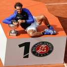 All smiles: Rafael Nadal celebrates winning his 10th title at Roland Garros after beating Stan Wawrinka
