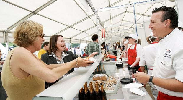 Connie Cunningham (left) and then Minister for Agriculture Michelle Gildernew at the Taste Fest