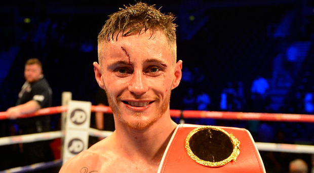 Ryan Burnett celebrates his IBF Bantam weight world title win over Lee Haskins at the SSE Arena in Belfast.