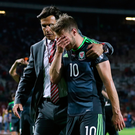 Big blow: Chris Coleman and a dejected Aaron Ramsey