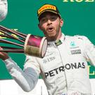 Mercedes driver Lewis Hamilton celebrates his victory at the Canadian Grand Prix.