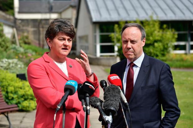 DUP leader Arlene Foster stands alongside deputy leader Nigel Dodds as they hold a press conference at Stormont Castle as the Stormont assembly power sharing negotiations reconvene following the general election on June 12, 2017 in Belfast, Northern Ireland. (Photo by Charles McQuillan/Getty Images)